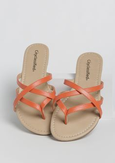 These cute orange faux leather sandals feature a strappy crisscross design and slip on styling.