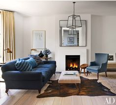 The London home of Oscar-nominated screenwriter Peter Morgan and his family was renovated by interior designer Rose Uniacke and architecture firm Eldridge Smerin. The living room features a Rose Uniacke Editions sofa and a wing chair by Humphrey-Carrasco; the mirror is from Hilary Batstone, and the lantern and cowhide rug were custom made.
