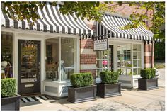 I like the striped awnings with brick/ door & window trim.