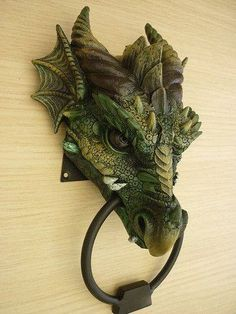 all the textural details are what make this wonderful - dragon doorknocker