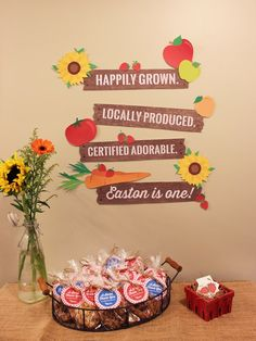 Favors + flowers + party signage from a Farmers Market 1st Birthday Party on…