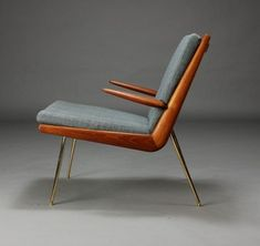 Peter Hvidt & Orla Mølgaard-Nielsen. Boomerang Chair. Lounge chair with solid teak frame, loose cushions upholstered in bluish wool, chromed brass legs. Designed in 1956. Produced by France & Søn, model FD-134.