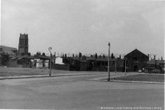 MSE/2/4/2 Black and white photograph showing a clearance area to the rear of St.Helens Parish Church, St.Helens .1962. . . . . ./ ./ .MSE - The Frank Sheen Collection 2 - Photographs showing various buildings, events and housing in St.Helens. 4 - Photographs showing areas in St.Helens