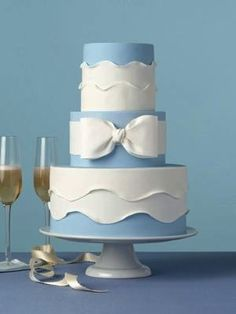 9ff3e2e6147 Formal Blue Wedding Cake - Soft ruffles and a sugar bow give this  traditional wedding cake a flirty finish.