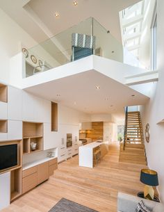 This home in Toronto features an upper level that overlooks the living room below.