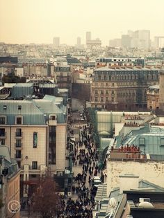 Paris Rooftops - The apartment we stayed in for the days were in Paris had this view.  Nothing like french wine from the veranda of the apartment.