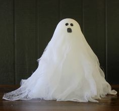 Don't be scared to make these fun Halloween crafts -- Cheesecloth ghosts! Create your own family full for use in displays for parties or holiday decorating.