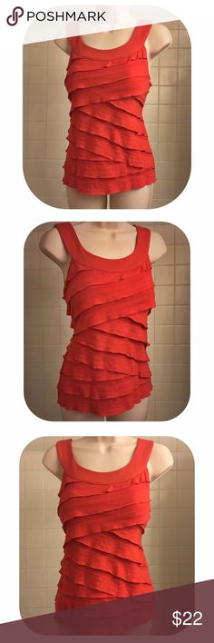 """Stunning Red-Orange Tiered Layer Top This stunning sleeveless red-orange scoop neck top features tiered semi sheer layers, in a diagonal cris-cross pattern, hi-lights curves & creates a flattering silhouette.  The layers fall over a sheer lining. This light & breezy top flows w/your body. Has some stretch to it. This top is perfect for summer, easily dressed up or down, for work or play. 24"""" long. Laid flat bust:17.5"""" across, waist: 15"""", bottom of the top: 18"""" across. Preloved, top is in…"""
