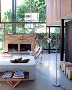Fine Interiors Wall of windows natural interior design concrete floors plants