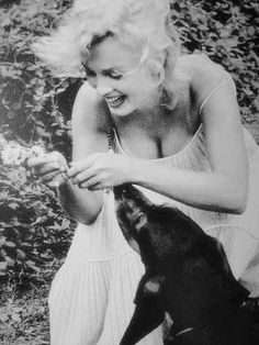 Marilyn Monroe with her and Arthur's dog Hugo.    [1957 by Sam Shaw]