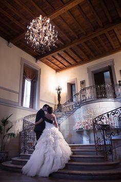Black Tie Bride and Groom in Chandelier Entranceway of Oheka Castle