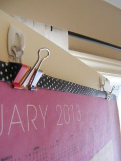 Use binder clips and Command hooks to hang things via The Complete Guide to Imperfect Homemaking
