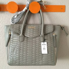 """XOXO handbag with strap extension! Very pretty bag, neutral color that goes with anything.  Good size: 11.5"""" tall, top is 17"""" wide, bottom is a bit narrower (12"""" by 5.5"""").  Has two zippered compartments near the sides.  Large front envelope pocket with magnet clasp flap.  Zipper on top to keep things safe and away!!  Really nice!  NWT! XOXO Bags"""