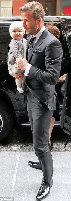 Beckham with baby with attractive grey suit  http://www.menssuitstips.com