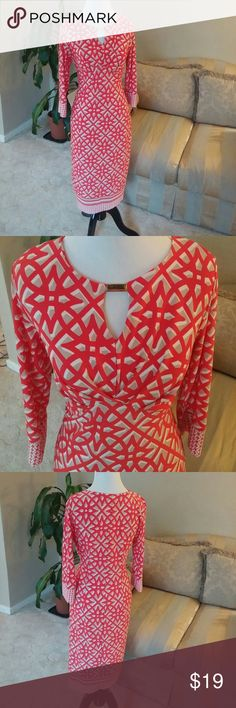 Beautiful Cato orangish/red with tan dress This is a beautiful orangish red dress with tan and white details as well. A gold buckle in the front and this is a size medium. Brand is CATO Cato Dresses Midi