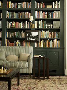 Bookshelf Living Room - bookshelf behind furniture + sliding doors + wall sconces on bookshelf