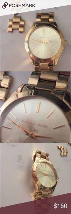 Boyfriend MICHAEL KORS WATCH For women- Michael Kors! Sorry I don't have the box. I wore this watch only 2x in the last year. My wrist is petit so it looked super bulky on my wrist. I do have the extra links it came with!   The writing on the back states that it is a Michael kors all stainless steel watch. 251508 5 ATM MK-3179 Michael Kors Jewelry