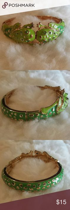 """Green Enamel Kissing Frog Bangle I fell in love with this and have never worn it.  Perfect whimsical bracelet for spring and summer.Lime and a grass green enamel set with green rhinestones on gold tone stretch.  1"""" at frogs and .5"""" at the rest. Stretchy 2.25"""" by 2.5"""" Jewelry Bracelets"""