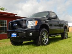 2014 Ford F-150 STX Regular Cab 4X4 with a custom leveling kit, 20-inch Nitto tires, custom window tinting and a durable spray in bedliner. #TruckAccessories #fordf150