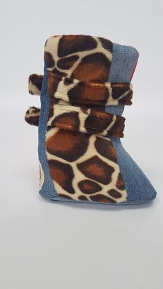 Stunning unique handmade boots, designed for Sa-Be by local fashion designer Terracharm Alexander. They are fleece lined, long in the leg and fasten with 2 slid
