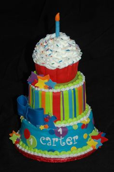 Cupcake boy first birthday with removable smash cake - BC fondant accents. Cupcake on the top is removable as a smash cake.