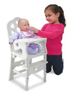 "Wooden Doll High Chair: Superior craftsmanship and charming details make our sturdy two-piece wooden high chair the perfect seat for a hungry doll! Featuring a removable, locking tray, this durable white chair will suit any décor and can accommodate dolls up to 20""."