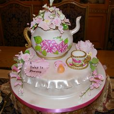 This adorable teapot is actually a cake! It was made for a Baby shower and it had a tea party theme. Sitting on top of a round cake is a teapot cake, covered in full fondant and hand-painted with the beautiful floral design. The small teacup on the side completes the look and some gumpaste flowers were also used to embellish the cake. A small fondant pacifier also serves as accent to the cake.