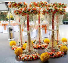 Yellow orange and white floral arrangements