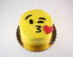 Face throwing a kiss emoji cake