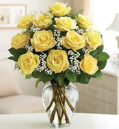 Rose Elegance™ Premium Long Stem Yellow Roses - the finest, freshest long-stem yellow roses arranged by hand with fresh gypsophila in a classic glass vase $59.99- $84.99 #yellowroses #rosebouquets