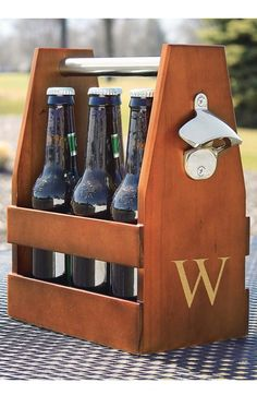 Wooden craft beer bottle carrier personalized with a large single initial features a side-mounted stainless bottle opener and round stainless carrying handle. Lagny Sur Marne, Initial Crafts, Craft Bier, Bottle Carrier, Wooden Crafts, Groomsman Gifts, Home Brewing, Woodworking Projects, Wood Projects