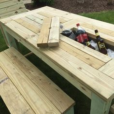 Drink Cooler Picnic Table. Constructed from Pressure Treated or Cedar Lumber. These table are built to last with a lifetime warrantee on the deck screws! Each cooler bay has enough space to hold a 12-24 12 oz. cans and bottles Handmade and made to order.
