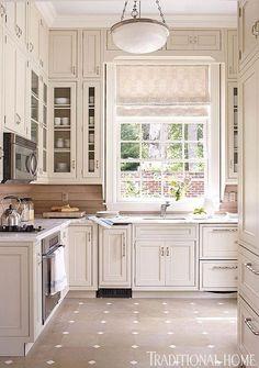 Beige & white square tile floor in cream beige kitchen