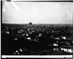 View from the top of Kountze Home on Forest Ave between 8th and 9th Streets. Grand Central Hotel is in the background (extreme right). High School is in the center background. [Photograph by E.A. Eaton] Label reads: 84. Northwest from South 16th Street.