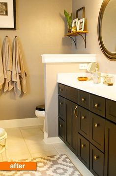 This is a before and after: really like the new dark cabinet, mirrors and gold accents.