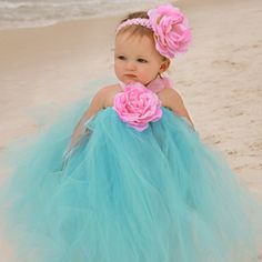 This gorgeous deep blue ocean tutu dress is photo shoot friendly and a wonderful choice for a summer wedding or other fanciful event.