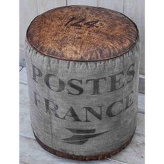 POSTES FRANCE ROUND OTTOMAN  The form of the Postes France Round Ottoman resembles an old vintage mail sack bringing to life an imagination of busy streets in Paris, the hustle and bustle of high society and long awaited letters from loved ones.