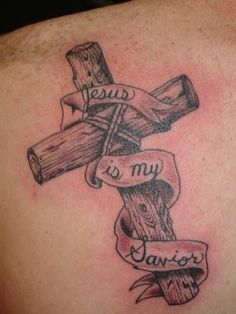 There are countless varieties of cross tattoos with the wooden cross being among the most popular ones. The wooden cross tattoos can be inked in any color with black and brown being the most popular since they give the tattoos a wood-like appearance. Engel Tattoos, Bild Tattoos, Religious Tattoo Design, Trendy Tattoos, Tattoos For Guys, Badass Tattoos, Wooden Cross Tattoos, Dorn Tattoo, Tattoo Sites