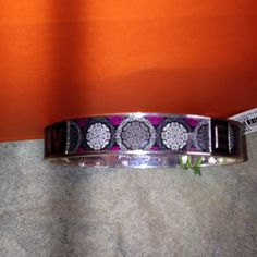Vera BradleyMulticolor bangle Vera BradleyMulticolor bangle with the letters Vera on it in silver, the other color: purple black,grey and white. This is one of the newest bangle, very Beautiful. Size 8 inch (New)No Trades, No PayPal Vera Bradley Accessories
