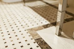 Small Powder Room floor idea - basketweave tile with black then white border