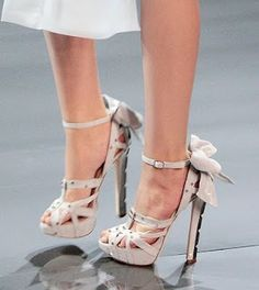 Christian Dior Haute Couture Fall-Winter 2008 - 2009.  These really cute shoes were worn by the model wearing them on the runway.  I LOVE it when heels have a bow on them.