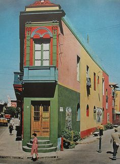 1960s colorful corner building multicolor painted facade architecture vintage photo (by Christian Montone)