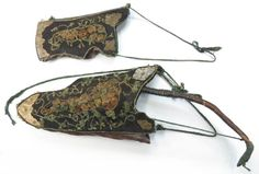A rare complete parade set, comprising a recurve bow covered in leather with ribbed grip, the cord intact, and a bowcase and quiver of leather, with wooden scales covered in velvet, the obverse elaborately embellished in embroidered flowering vinework with profiled brass plates riveted at the base and corners. 17th century or later. The bow with apparent crack beneath torn and abraded leather, general rubbing to the bowcase and quiver. Based on Ottoman prototypes. Length of bow 104.5 cm…