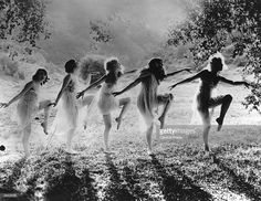 A group of women dancing in the open air.
