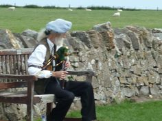 Holy Island Lindisfarne Piper playing the Northumbria pipes