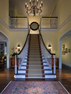 Beautiful stairs! Love the chandelier!
