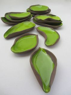 """Appetizer dishes in natural shapes. """"Chocolate-Pistachio"""" series (brown clay, apple green glaze). Hand built earthenware ceramics by Pottery Studio Saskia Lauth / France. www.saskia-lauth.com"""
