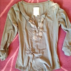Gilly Hicks 3/4 Sleeve V-neck gray Shirt Size Med Gilly Hicks by Abercrombie and Fitch shirt. Size medium. 3/4 sleeves. V neck with flower embellishments. Gilly Hicks Tops Tees - Short Sleeve