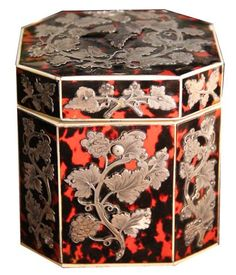 An Early 19th Century English Silver-Mounted Red Tortoiseshell Tea Caddy, with bone trim and octagonal in shape with applied fruiting grapevines and matching lid