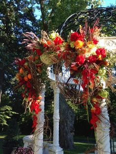 The perfect setting for a fall garden wedding gazebo highlighted with gladiolas, roses, roses, roses, millet, hydrangea and grape vines ... breathtaking! — at Larimore House Plantation Wedding Ceremony & Reception Venue. Floral Decor by Jenny Thomasson AIFD CFD of Stems Florist in St. Louis, MO  #gazebo # fallwedding